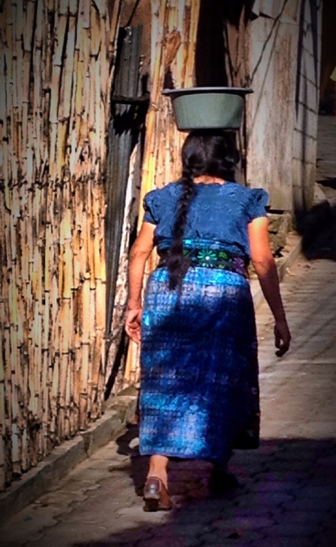 The Mayan women all carry their cargo this way