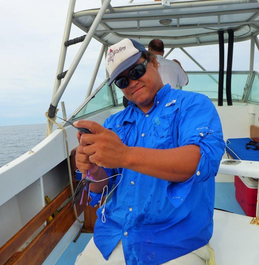 David was sewing up baitfish getting them ready to battle some billfish