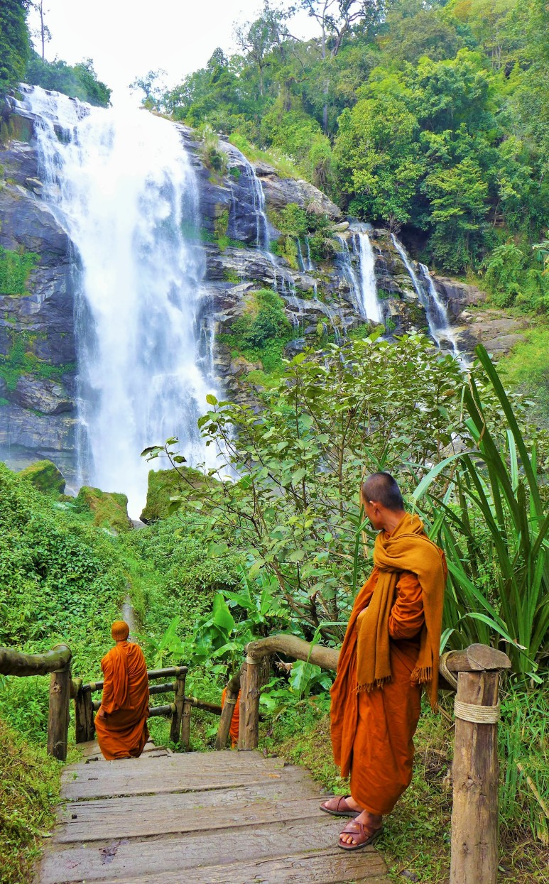 orange robed monks also admiring the falls