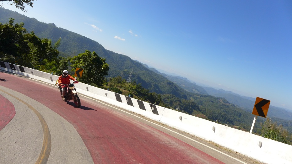 curve after curve await on the Mae Hong Son loop.. The really tight ones are marked by red pavement.