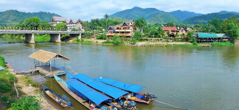 Long boats ready to transport travellers down the river Kok