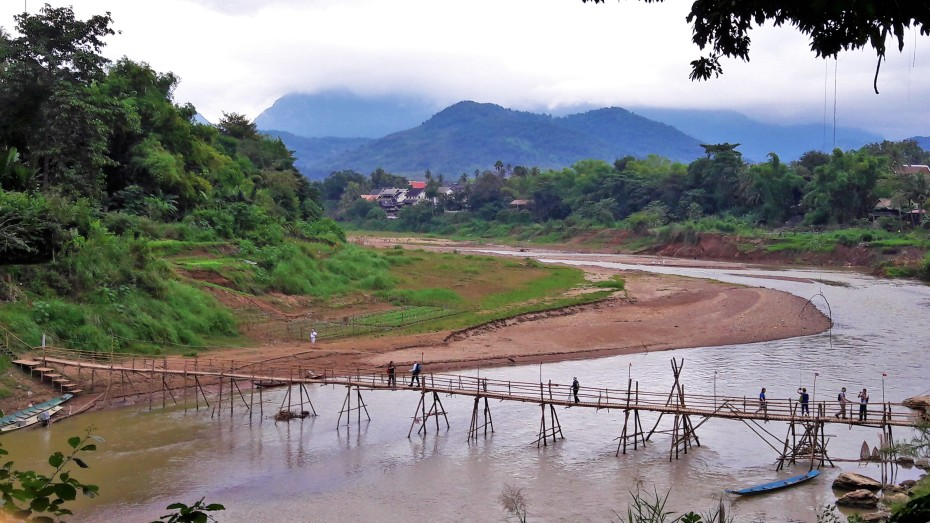 a bamboo bridge river crossing in Luang Prabang