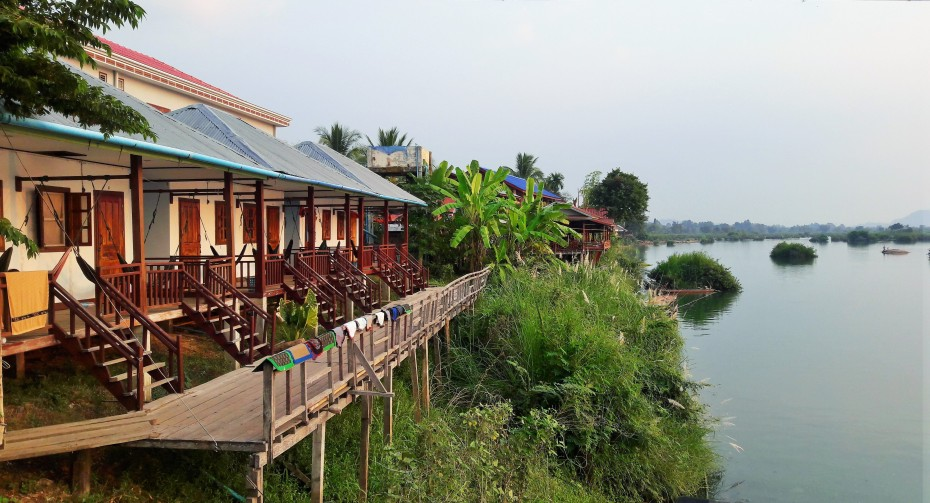 sunset side bungalows line the rivers banks